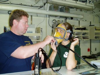 The maritime heritage team dons agamasks in the dry lab to get practice in using their new underwater communication system.  Photo: Claire Johnson/NOAA