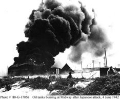 Photo # 80-G-17056  Oil tanks burning at Midway after a Japanese attack, 4, June 1942. Bishop Museum.