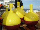 yellow and red spherical buoys