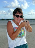 Ann Bell, US FWS Educator with baby green sea turtle.